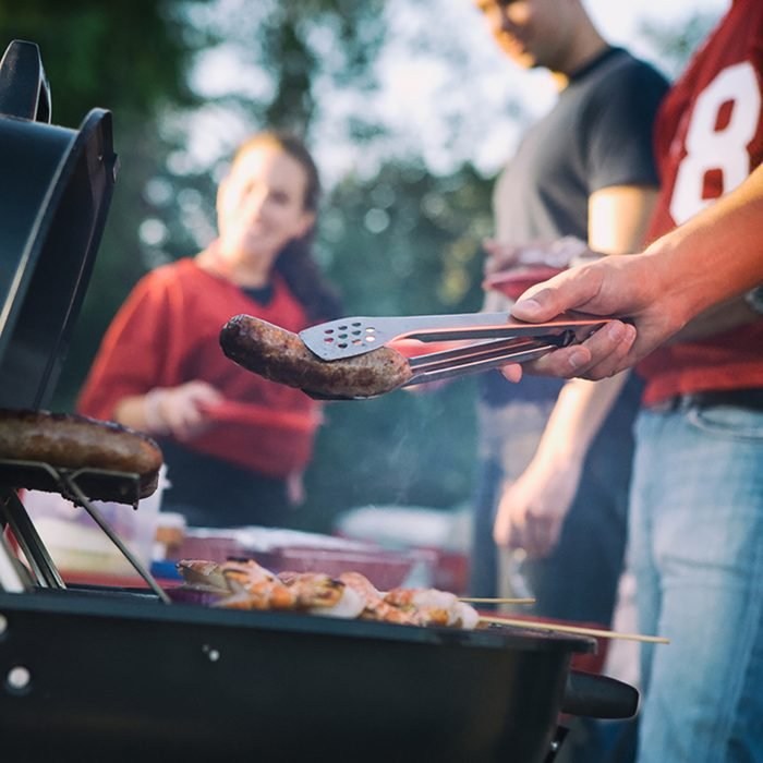 Tailgate: Man Works The Grill At Tailgating Party