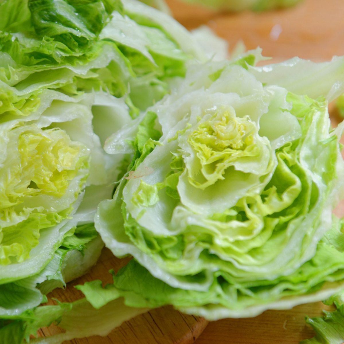 Fresh Green Iceberg lettuce prepared on table
