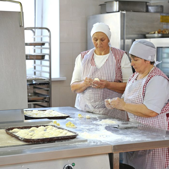Cook make dumplings standing behind the kitchen counter. Day of opened door for mass-media in the Ukrainian parliament canteen. November 23. 2017. Kiev, Ukraine ; Shutterstock ID 761546422; Job (TFH, TOH, RD, BNB, CWM, CM): TOH