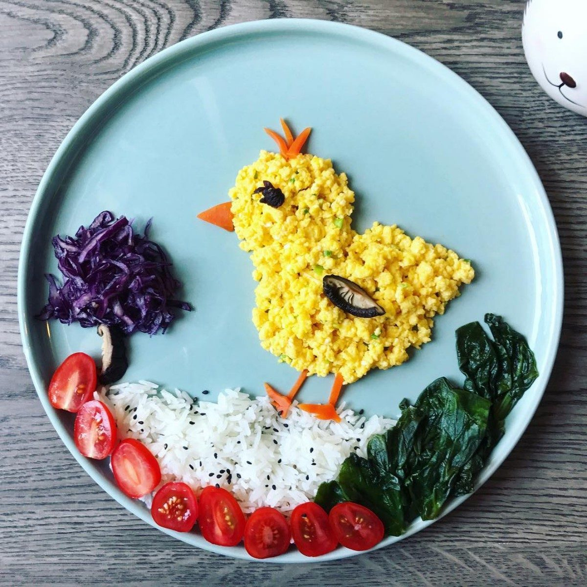 chicken shaped plate of food