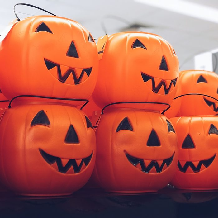Jack-o-lantern trick or treat jars at store shelves for sale by Halloween season;