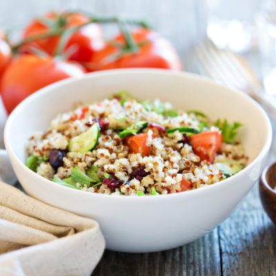 Quinoa salad with fresh tomatoes, cucumbers and salad leaves