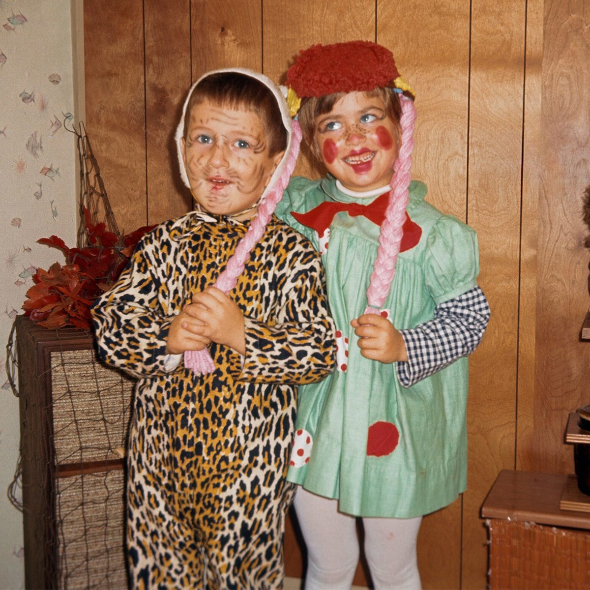 children dressed as a leopard and raggedy anne for Halloween