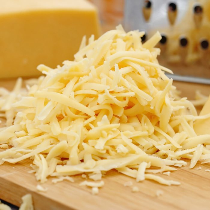 Grated cheese on the wooden table