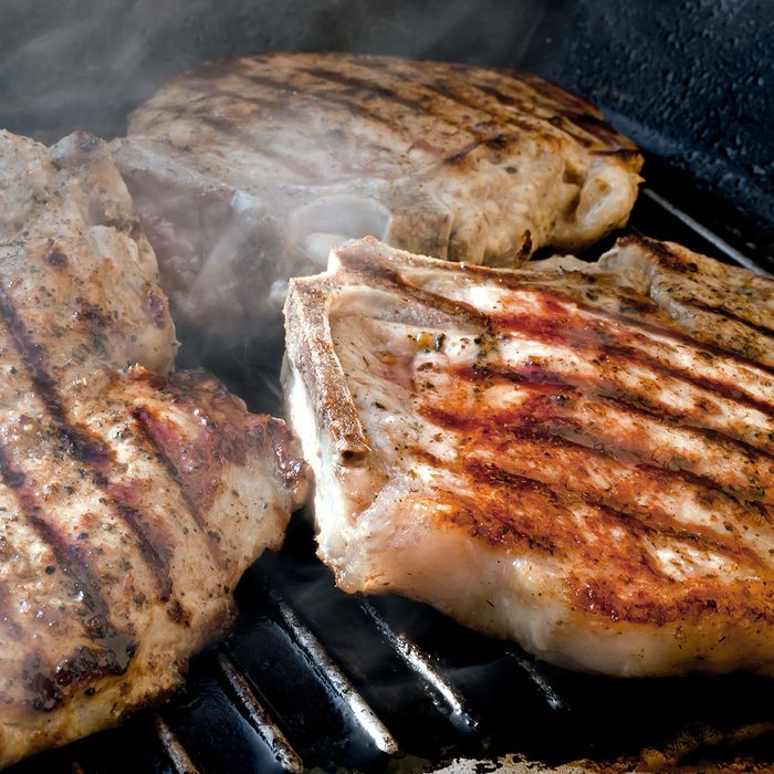 Pork chop grilled with delicious toasted traces and fragrant smoke; Shutterstock ID 100378781; Job (TFH, TOH, RD, BNB, CWM, CM): Taste of Home