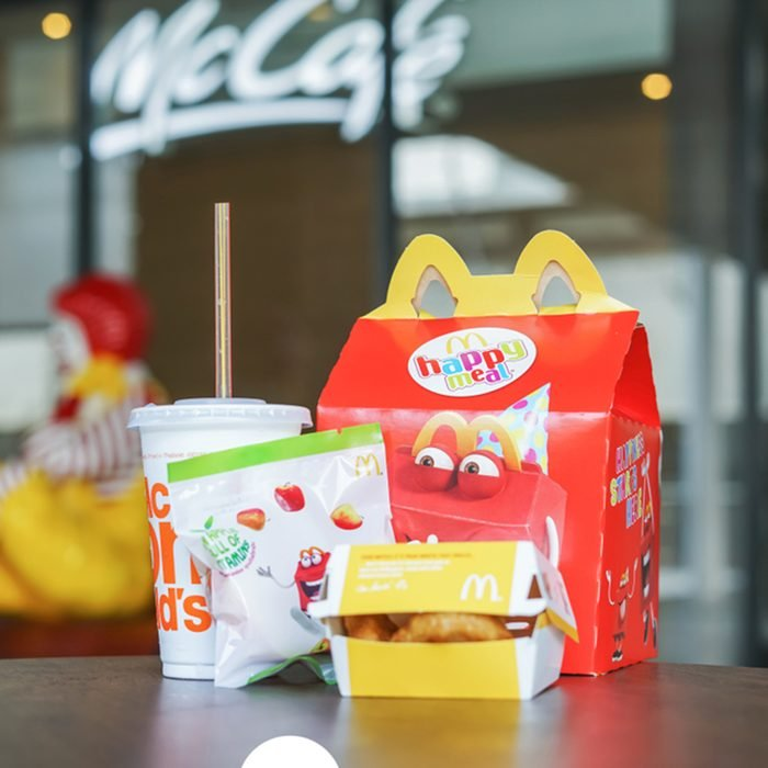 BANGKOK,THAILAND - JANUARY 9,2018 : Happy meal set on desk ,in soft focus, with blurred Ronald McDonald at McDonald's restaurant; Shutterstock ID 1013839621; Job (TFH, TOH, RD, BNB, CWM, CM): Taste of Home