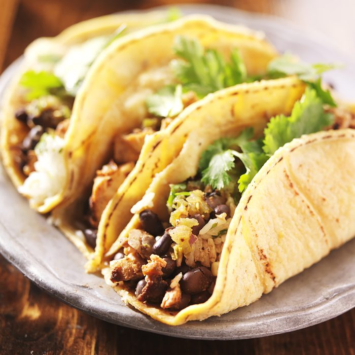 Tacos - in mexican yellow corn tortilla with chicken