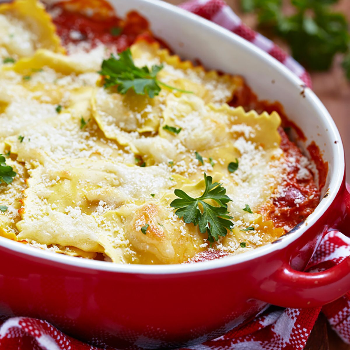 Baked ravioli with ham and cheese in tomato sauce