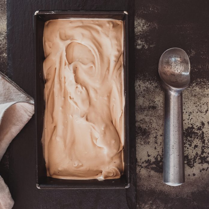 Homemade ice cream in frozen metallic tray on rustic surface. Top view, dark toned image, blank space; Shutterstock ID 569620816; Job (TFH, TOH, RD, BNB, CWM, CM): Taste of Home