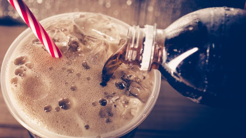 Refreshing Bubbly Soda Pop with Ice Cubes. Cold soda iced drink in a glasses - Selective focus, shallow DOF.; Shutterstock ID 631176569