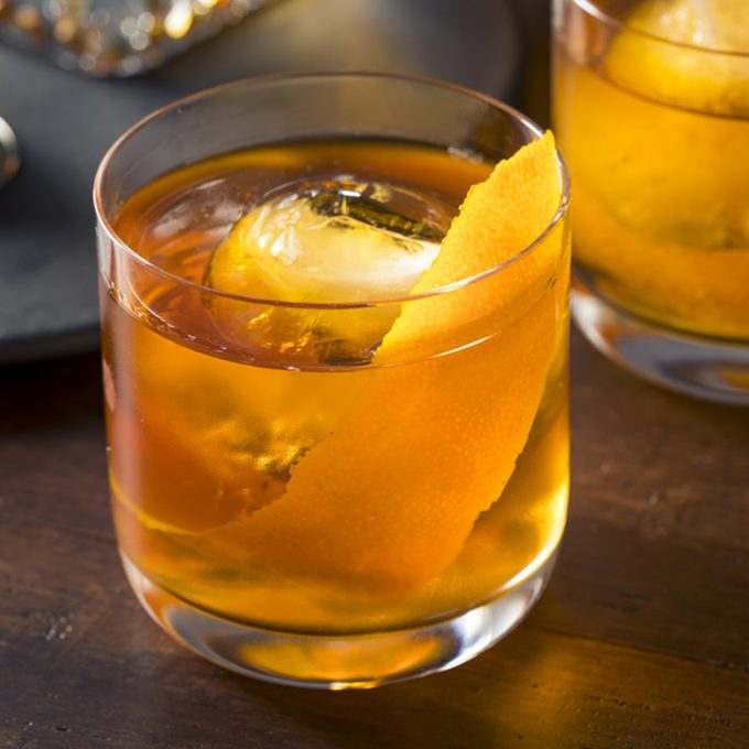 Homemade Boozy Old Fashioned Cocktail with Whiskey and a Sphere Ice Cube; Shutterstock ID 656783038; job: Taste of Home