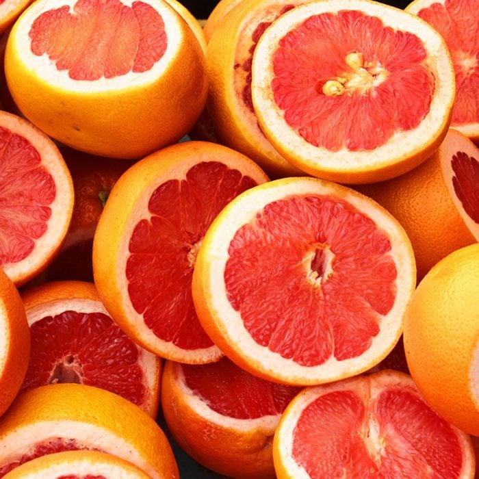 Pile of fresh grapefruits on display at street market