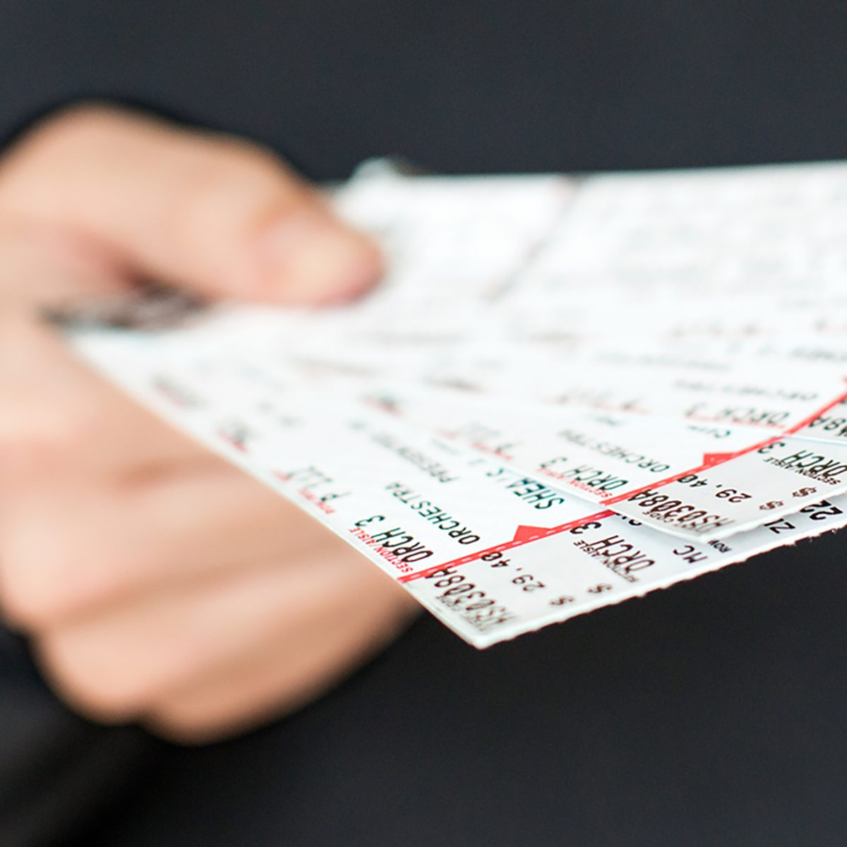 Tickets being held in a hand
