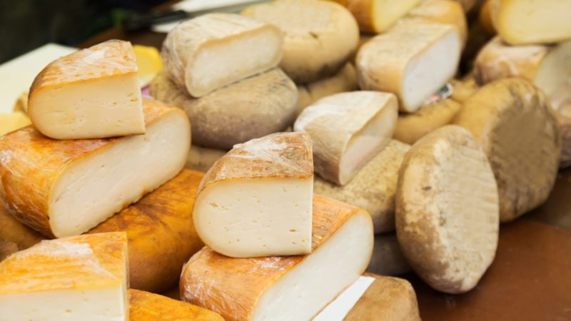 Cheese in packs and in bulk at market counter