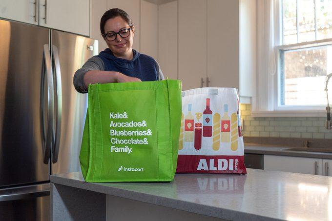 Woman unpacking Instacart groceries