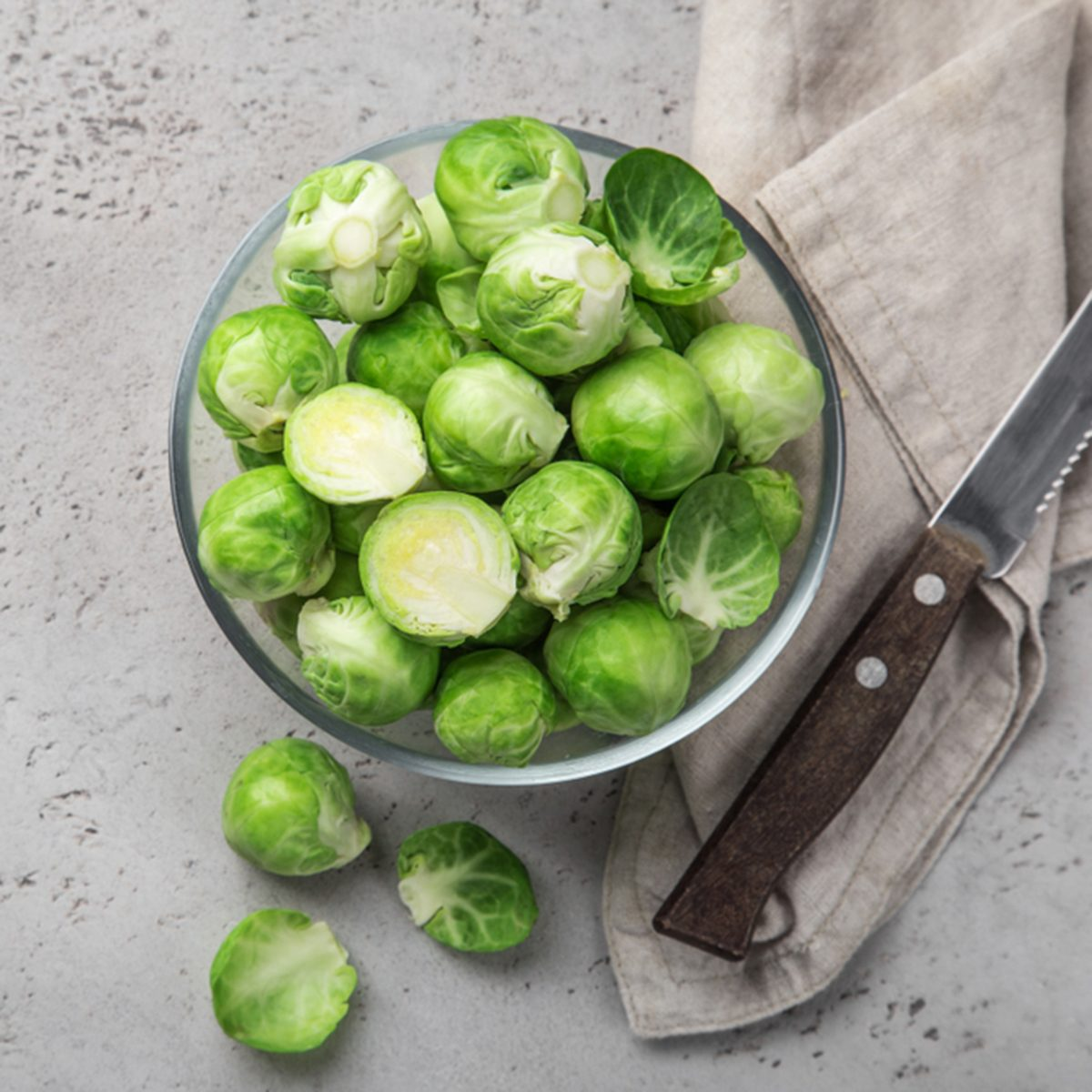 fresh raw brussel sprouts in glass bowl.