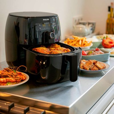 black philips air fryer with food inside