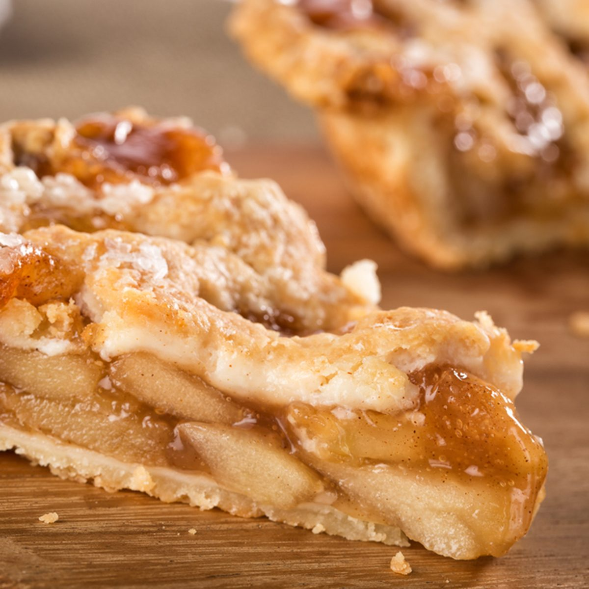 Slice of mouth watering rustic apple pie