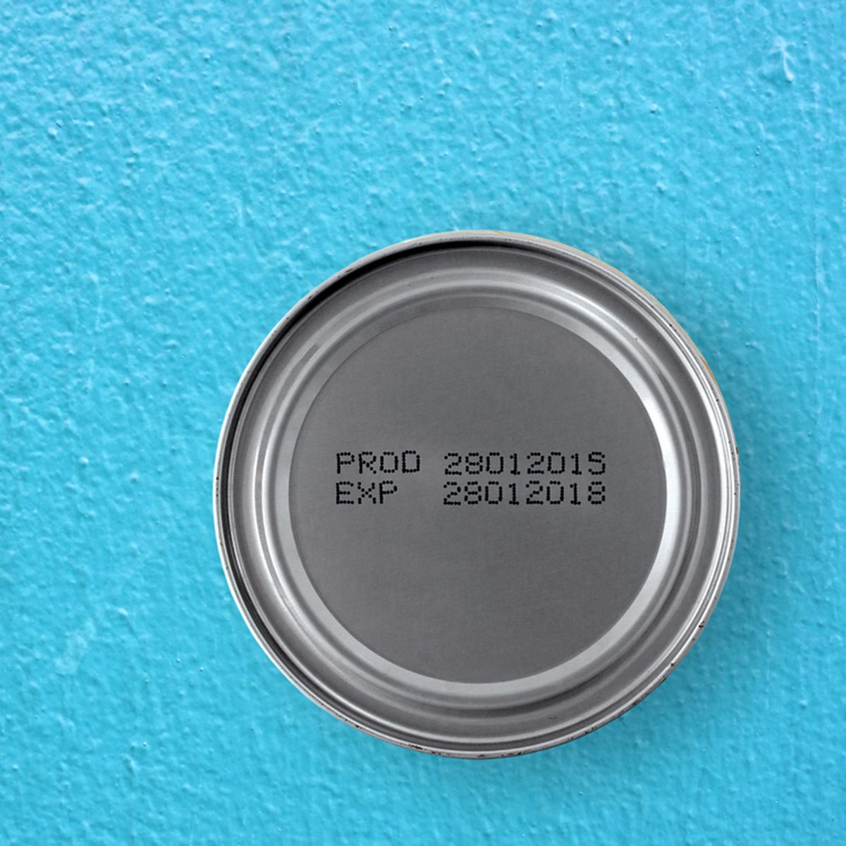 manufacture date and expiry date printed on the bottom of aluminum cans on blue cement table background