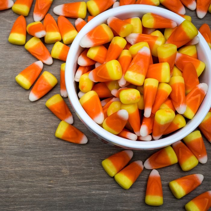 Classic white, orange and yellow candy corn sweets for Halloween