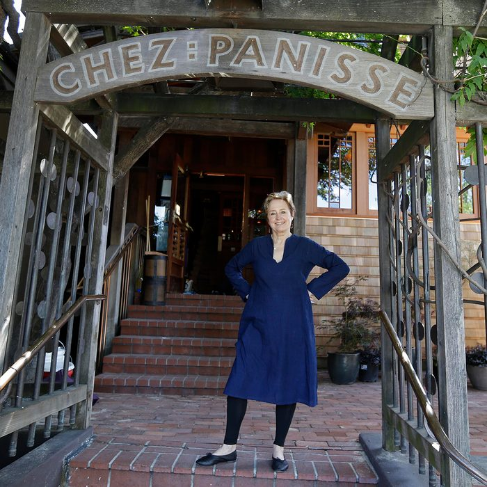Alice Waters poses outside the new front entrance to Chez Panisse restaurant in Berkeley, Calif.