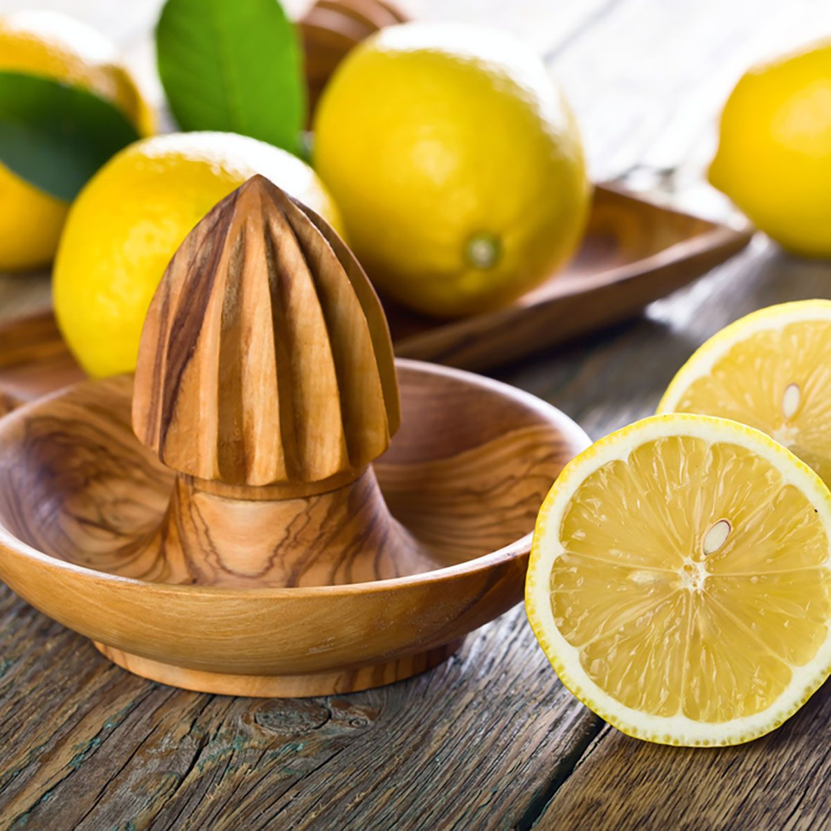 Ripe lemons and squeezer on a old wooden table .; Shutterstock ID 679854553; Job (TFH, TOH, RD, BNB, CWM, CM): Taste of Home