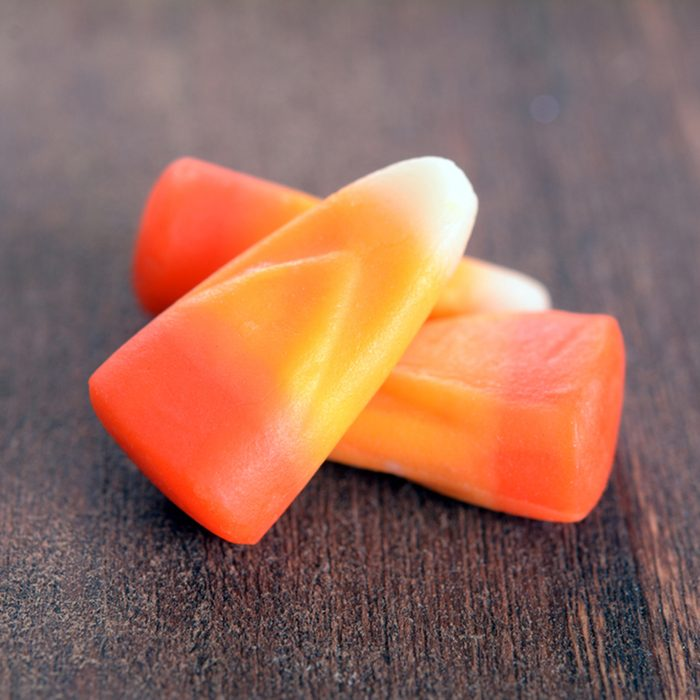 candy corn for Halloween on rustic table