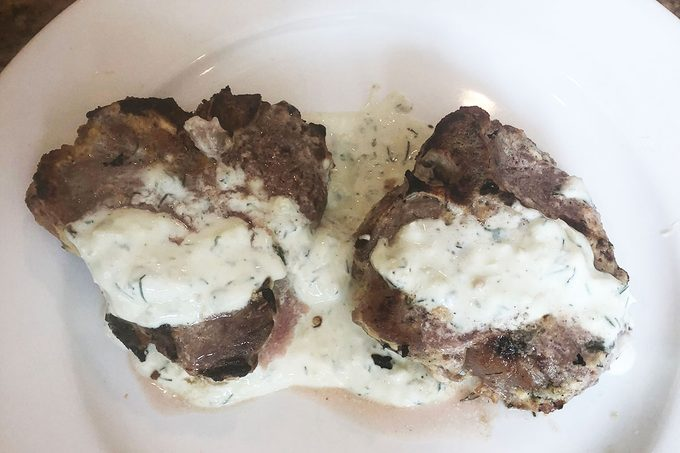 Cooked lamb with ranch dressing