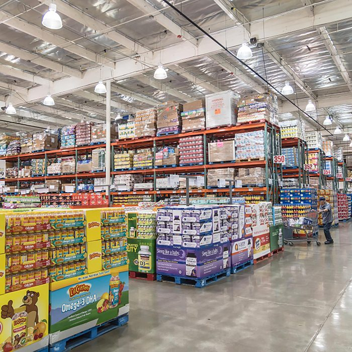 Customer shopping for supplements and multivitamin at Costco Wholesale big-boxes store.