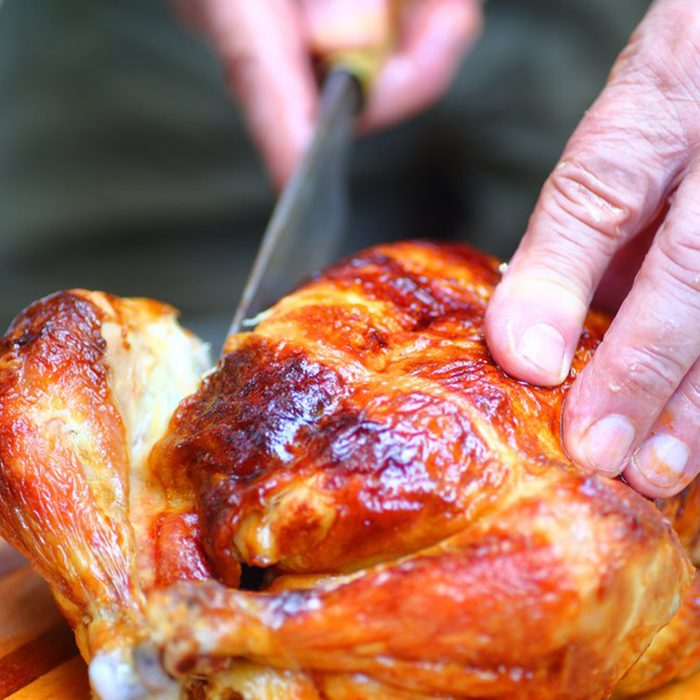 Cutting into a cooked chicken