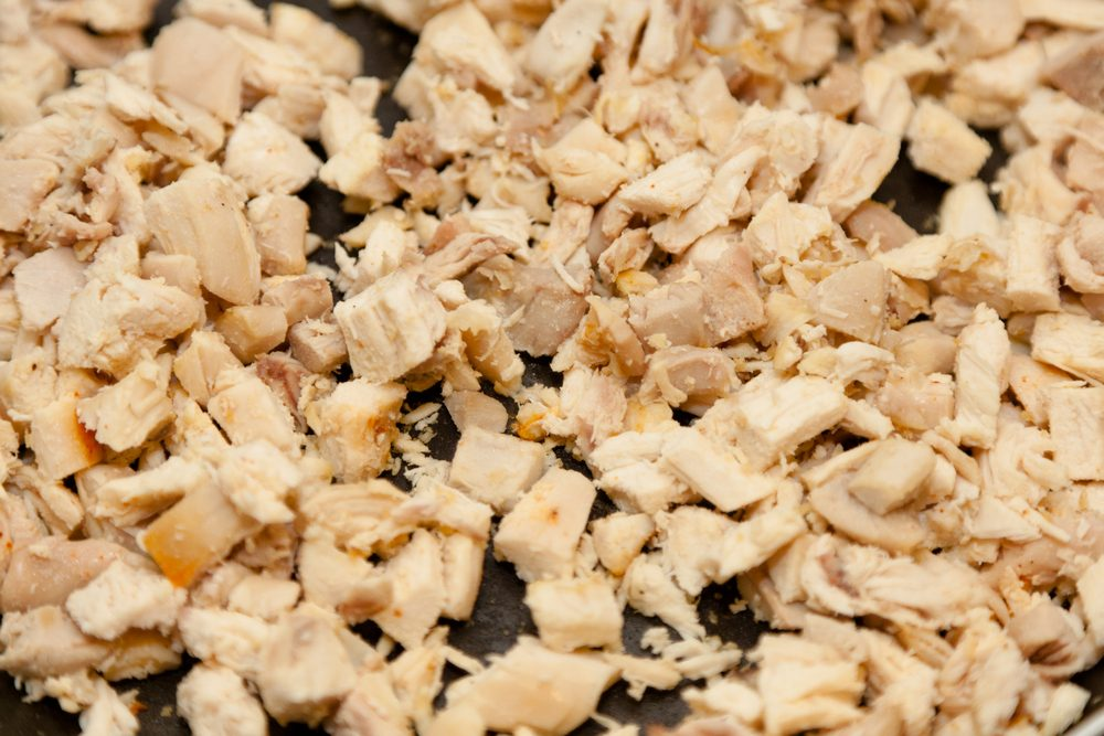 Diced chicken breast fried on large pan.; Shutterstock ID 96981731; Job (TFH, TOH, RD, BNB, CWM, CM): TOH Frozen Chicken Recall