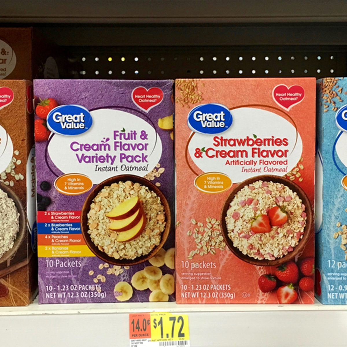 Grocery store shelf with boxes of Great Value generic flavored instant Oatmeal packages.