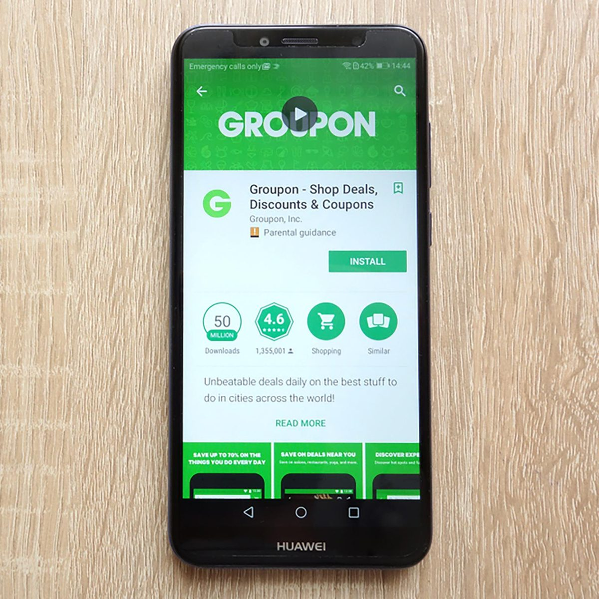 Groupon - Shop Deals, Discounts and Coupons app on Google Play Store website displayed on Huawei Y6 2018 smartphone