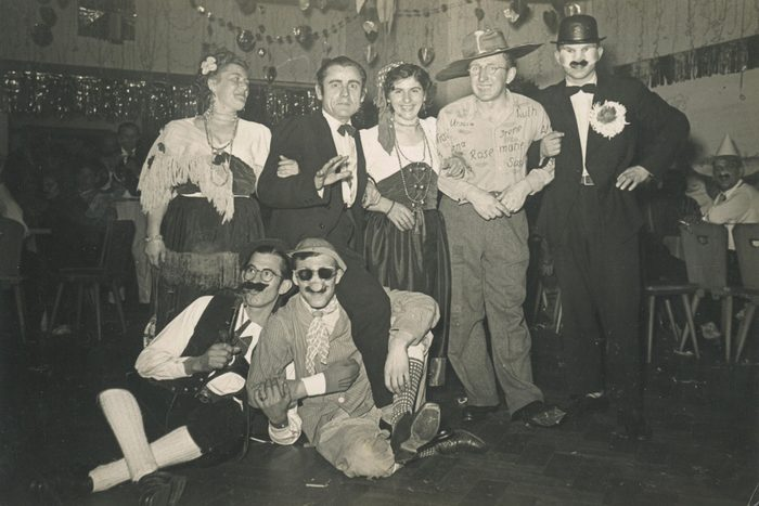 Portrait of a group of friends in fancy dress on a night out, circa 1950s