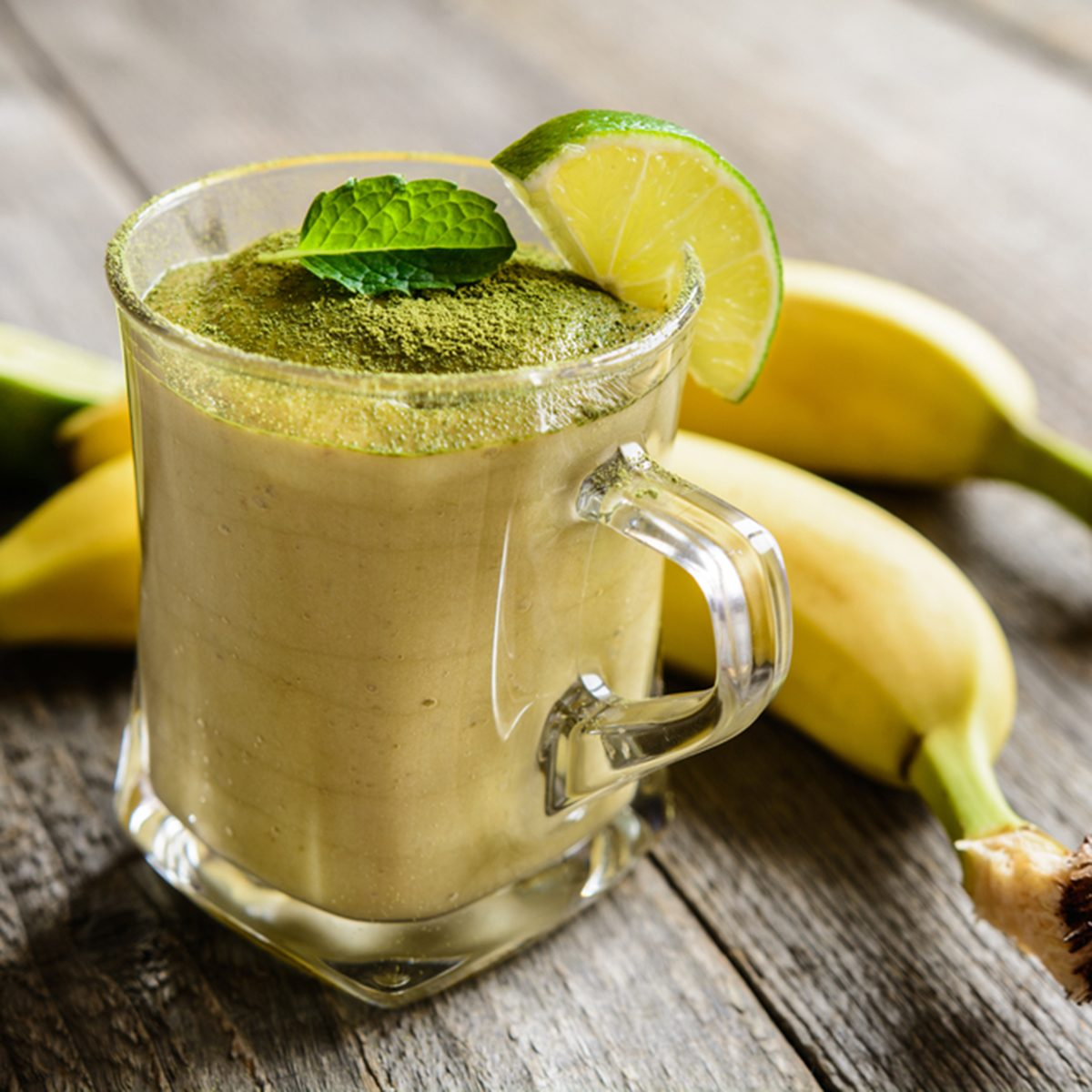 Healthy smoothie with banana and Matcha tea in a glass jar