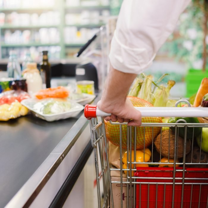 Man buying food products in the supermarket shopping