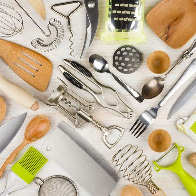 Background of kitchen utensils on wooden kitchen table