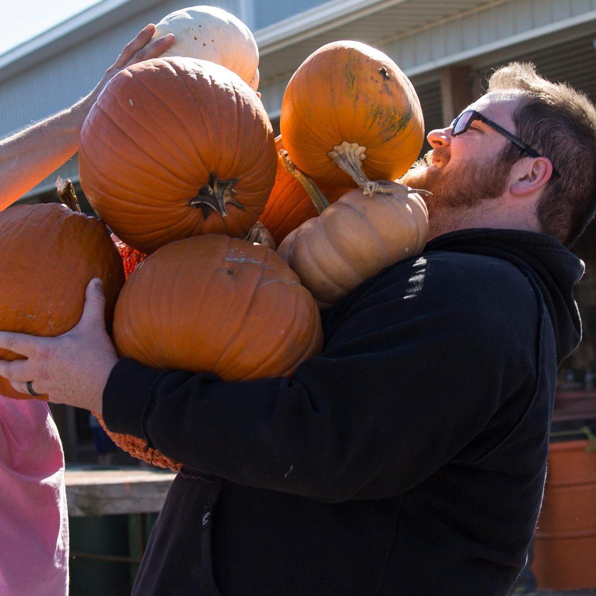 Man carrying pumpkins