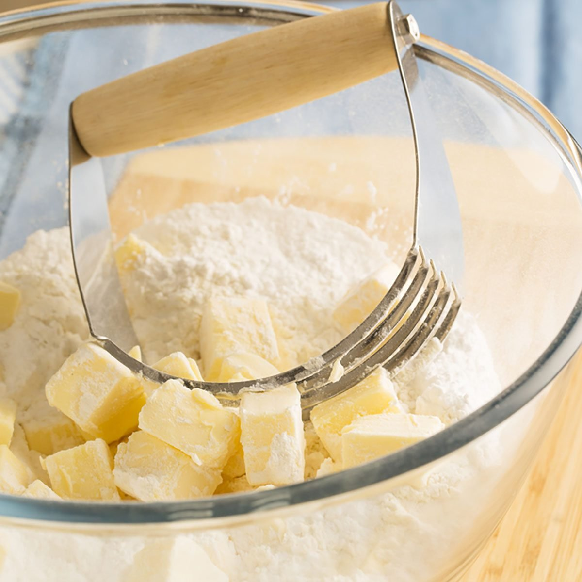 Butter in bowl with flour and handheld pastry blender.; Shutterstock ID 210190156