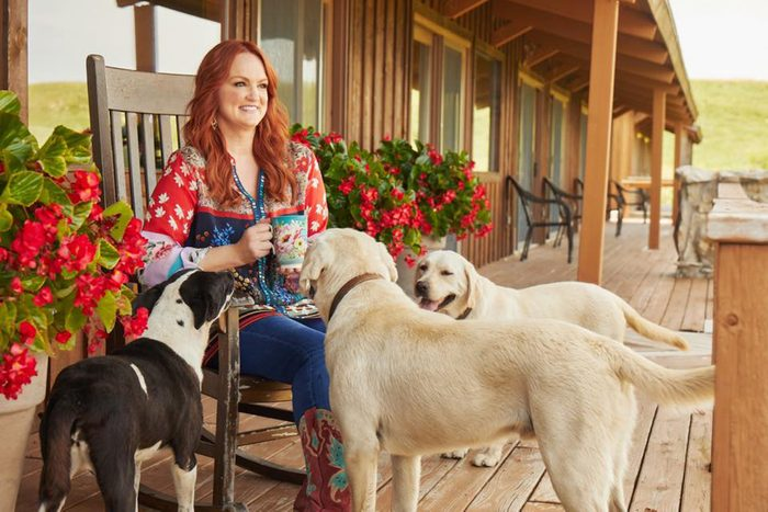 Pioneer woman with three dogs