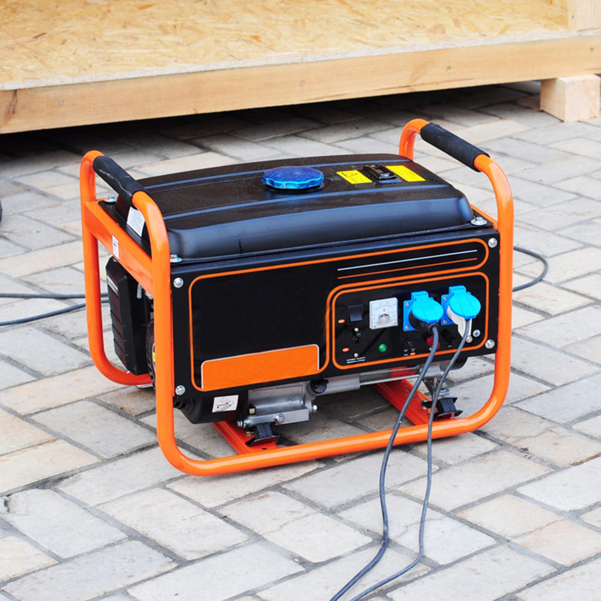 Gasoline Portable Generator on the House Construction Site.