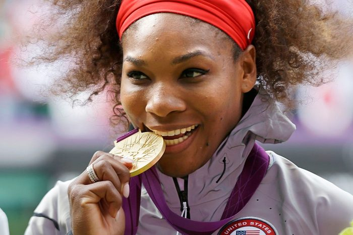Serena Williams posed with her 2012 Summer Olympics gold medal during the podium ceremony of the women's singles final match at the All England Lawn Tennis Club at Wimbledon, in London. Williams has been named the WTA's Player of the Year after winning major titles at Wimbledon and the U.S. Open, and claiming gold at the London Olympics SWilliams Player of Year Tennis