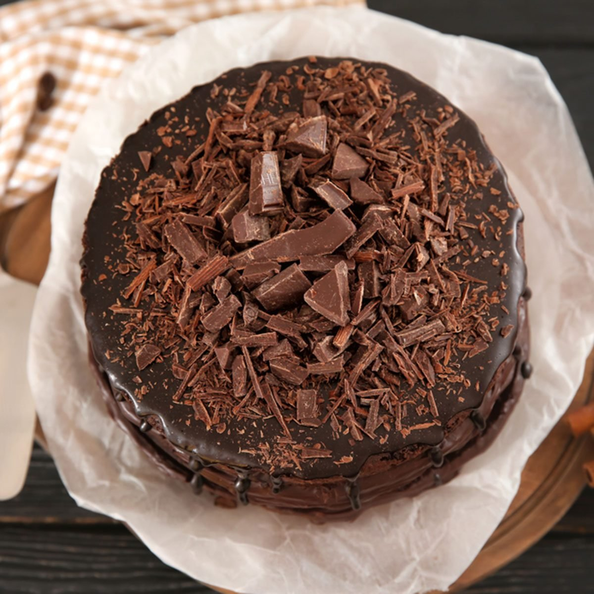Board with delicious chocolate cake on wooden table; Shutterstock ID 1156703284; Job (TFH, TOH, RD, BNB, CWM, CM): Taste of Home