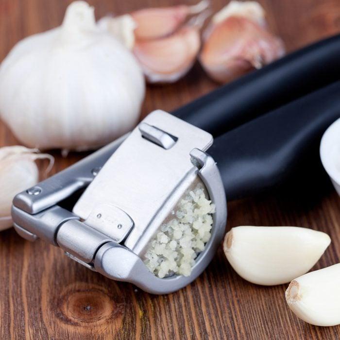 Garlic press and garlic; Shutterstock ID 154261304; Job (TFH, TOH, RD, BNB, CWM, CM): Taste of Home
