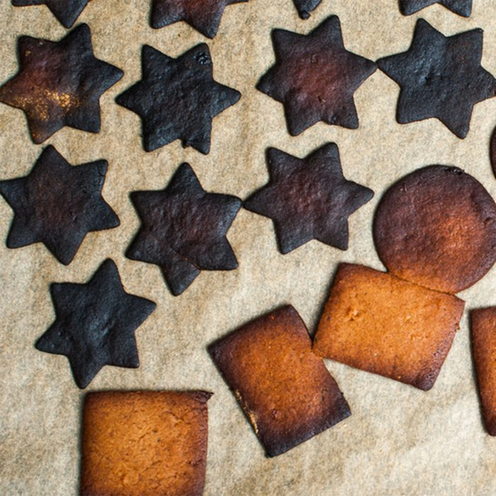 Baking tray with burnt gingerbread cookies; Shutterstock ID 238370437