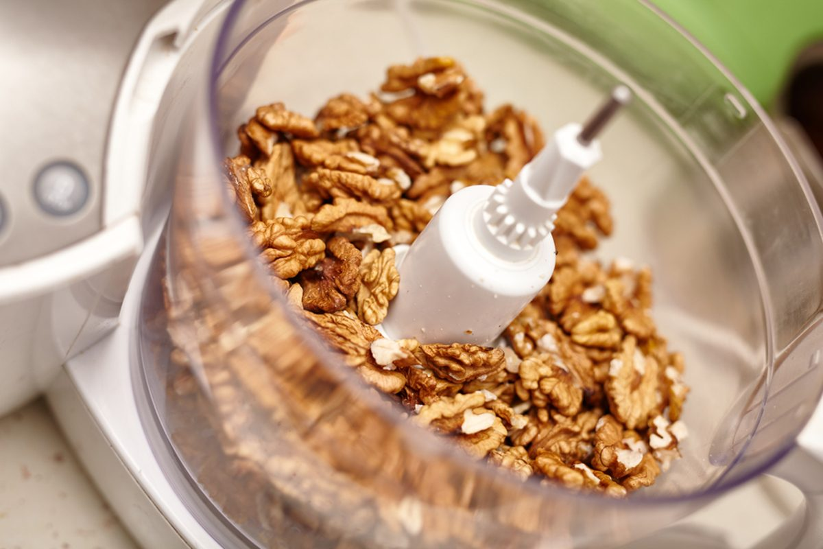 Kernel walnuts in a food processor ready to be crushed for prepare dessert; Shutterstock ID 257564434; Job (TFH, TOH, RD, BNB, CWM, CM): Taste of Home
