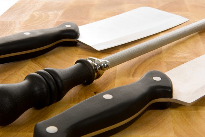 Kitchen knives including chef's knife, cleaver and sharpening steel on wooden cutting board; Shutterstock ID 2740749; Job (TFH, TOH, RD, BNB, CWM, CM): Taste of Home