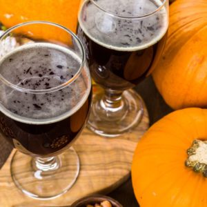 Craft pumpkin beer in beer glasses with salty pretzels and popcorn.; Shutterstock ID 334622504; Job (TFH, TOH, RD, BNB, CWM, CM): Taste of Home