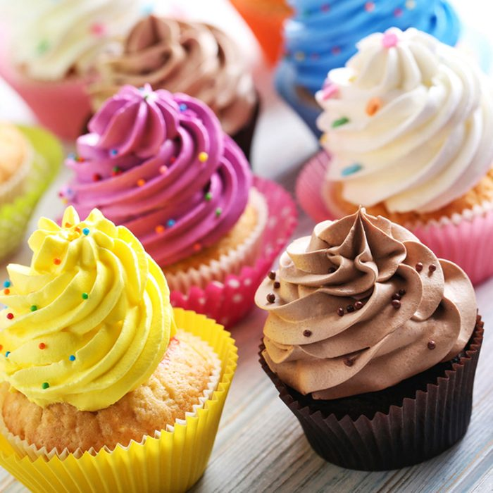 Tasty cupcakes on a white wooden table; Shutterstock ID 556435444; Job (TFH, TOH, RD, BNB, CWM, CM): Taste of Home