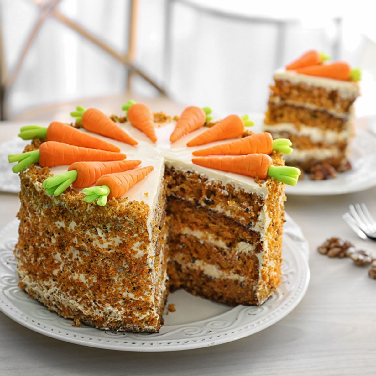 Delicious sliced carrot cake and tea on table; Shutterstock ID 693446158; Job (TFH, TOH, RD, BNB, CWM, CM): Taste of Home